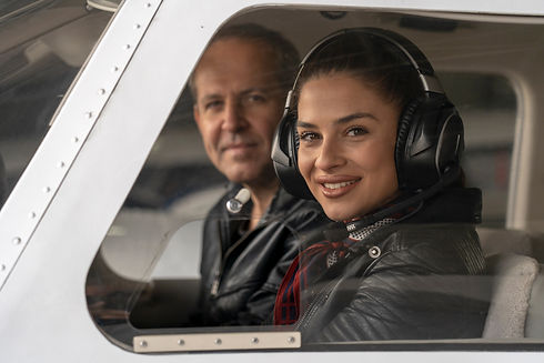 Smiling Female Pilot and Flight Instruct