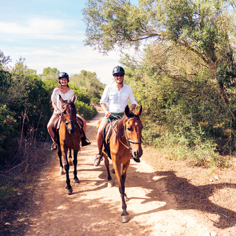 Young Tourist Couple Horseback Riding.jp