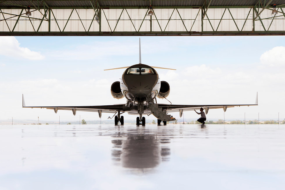 Pilot checking wing of private jet.jpg