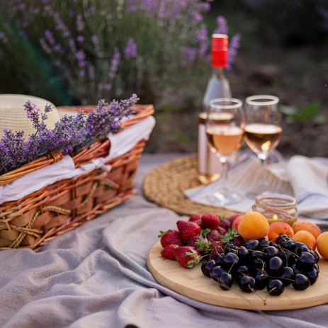 Romantic picnic in nature with fruits, b