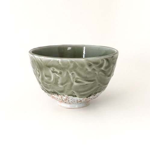 Porcelain bowl green celadon glaze
