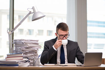 young-businessman-drinking-tea-office_85