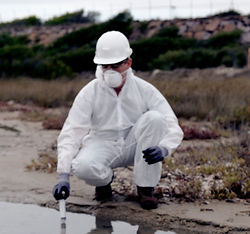 Technical in a protective suit examining