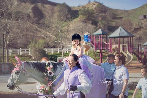 Little Girl Riding Medieval Unicorn at Party Los Angeles.jpg