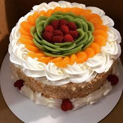 Pandan cake with mandarin oranges, kiwi,
