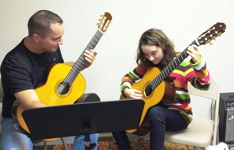 Image of Douglas Seth teaching a young student