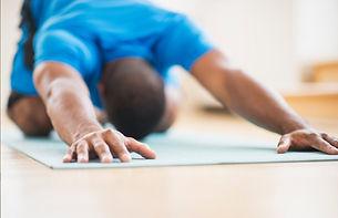 man-stretching-on-yoga-mat.jpg