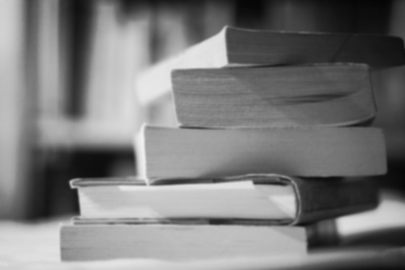 A stack of books in black and white