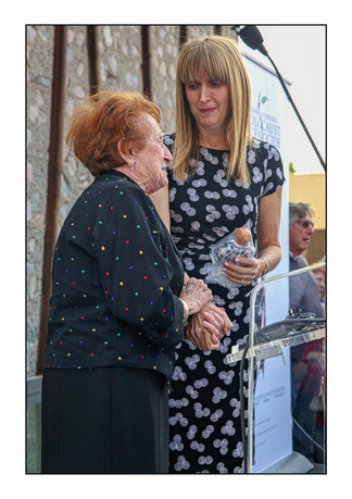Holocaust survivor Veronica Phillips presents Tali Nates, director of the Johannesburg Holocaust & Genocide Centre, with a personal artifact at the JHGC's dedication ceremony, September 2015.   Forest Town, Johannesburg, Gauteng, South Africa.