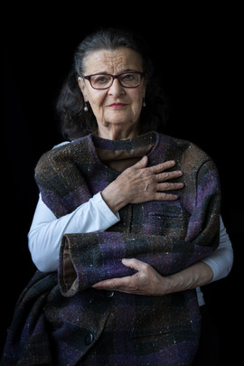 """Hania Rosenberg b. 1934 Oświęcim, Poland Arrival in Sweden: 1946  OBJECT: Mother's coat  """"This is my mother's coat that she had for some 20 years before she passed away. I keep it because it makes me feel she is always with me. I put it on sometimes to be near her. My mother protected me all of my life, and her coat still protects me today."""""""
