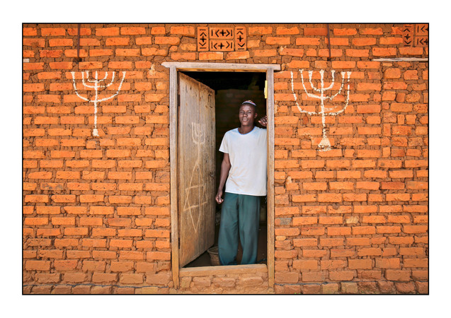 -- Abayudaya Jews --  Joseph Mwanika in the doorway of a house.  Nalubembe Village, Kikubu District, Uganda.