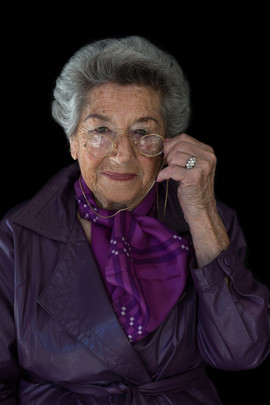 """Ella Blumenthal b. 1921 Warsaw, Poland Arrival in South Africa: 1948  OBJECT: Pince-nez  """"I was given these pince-nez as a gift when I arrived in South Africa. They remind me of the fashions of a bygone era. When I wear them today, I still feel elegant and smart."""""""