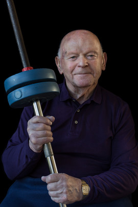 """Ben Helfgott Sir b. 1929 Pabianice, Łódź, Poland Arrival in UK: 1945  OBJECT: Barbell  """"All of my adult life I have striven to overcome bigotry and racial prejudice brought about by ignorance and intolerance. To this purpose, I spend most of my time promoting research, education and remembrance of the Holocaust in the hope that its lessons may be learned and understood. Weightlifting helped me achieve the confidence to do this work.""""  * Ben represented the UK for weightlifting at the 1956 Summer Olympics in Melbourne, Australia."""