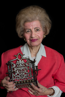 """Hedi Fisher b. 1927 Balassagyarmat, Hungary Arrival in UK: 1946  OBJECT: Hanukkiah (purchased in Israel approx. 1990)  """"I was brought up in Hungary by orthodox parents. When I saw this Hanukkiah in a shop window in Tel Aviv, I bought it because it reminded me of my childhood. But it also expresses my love for Israel where I have been every year since 1956."""""""