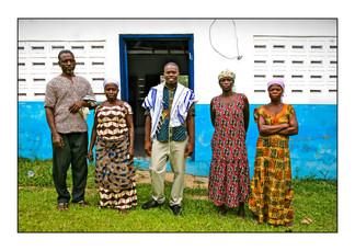 Spiritual leader Alex Armah (center) with community members after shacharit (morning) service at Tifereth Israel Synagogue, House of Israel Jewish Community.  New Adiembra, Sefwi Wiawso, Western Region, Ghana.