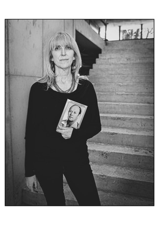 Tali Nates, director of the Johannesburg Holocaust & Genocide Centre, with a photograph of her father who, along with his brother, was saved by Oskar Schindler.  Forest Town, Johannesburg, Gauteng, South Africa.