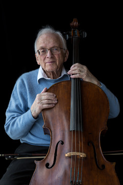 """Fred Knoller b. 1921 Vienna, Austria Arrival in UK: 1952 (via USA)  OBJECT: Cello  """"My parents were musical. We were three brothers. The eldest played piano. My middle brother played the violin. And I learned to play the cello from age 8. I love playing the cello. It makes me feel wonderful and alive. Playing the cello takes me back to my childhood."""""""