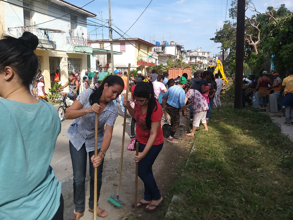 Seminary Students helping clean the streets in Santo Suarez