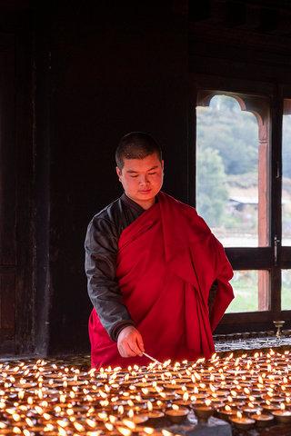 Lighting candles, Bhutan