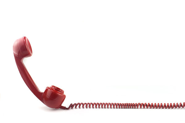 Old fashioned 1970's or 50's style red telephone.jpg