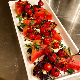 Grilled Halloumi with Watermelon, Blistered Tomatoes, Basil Oil & Mint