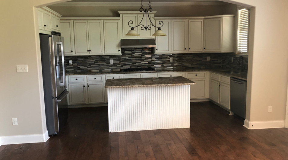 Gourmet Kitchen with Granite Countertops, Backsplash and stainless-steel appliances