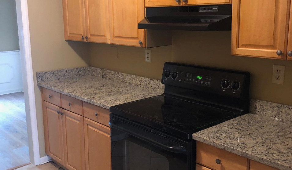 Kitchen with stove and granite countertops