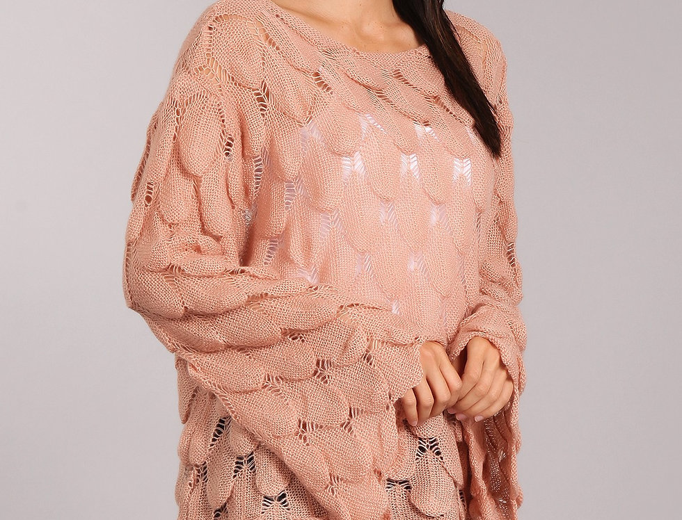 Knitted pullover sweater with sleeves and fits loose