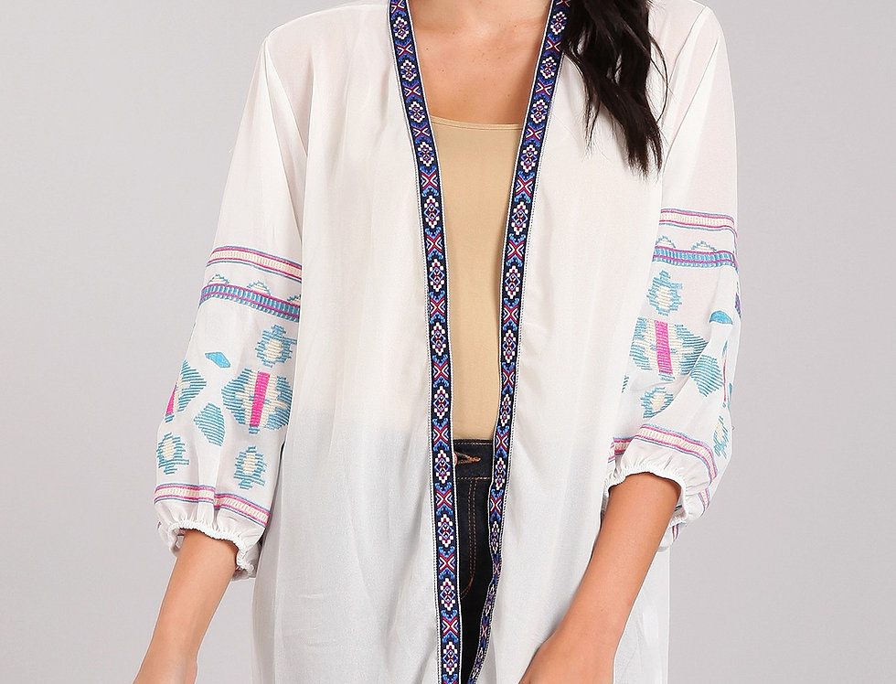 solid long body cardigan in a loose fit with an open front hi-lo