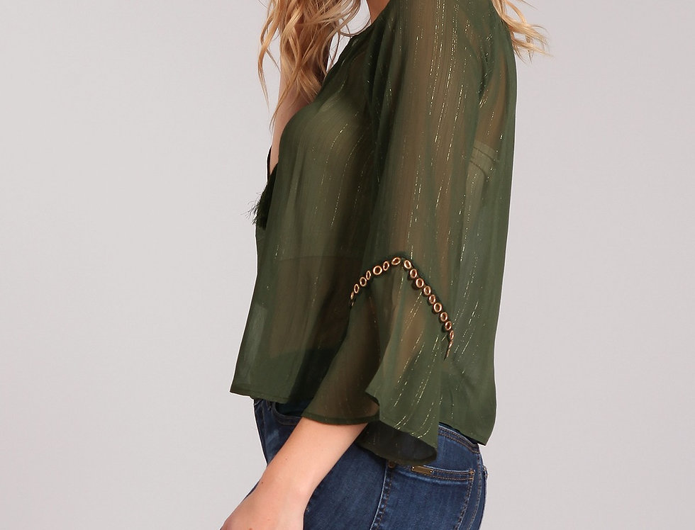 solid,sheer,waist length top in a relaxed fit with a boat necklin