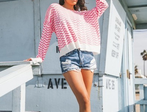 Crochet knit long sleeve blouse in an allover abstract print.