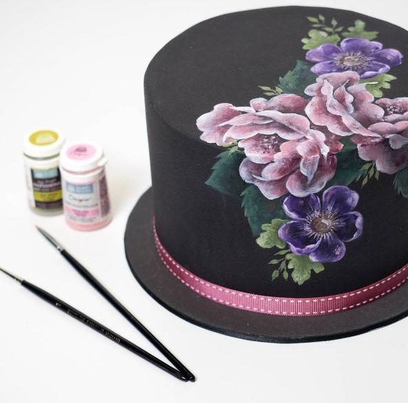 Dark floral painted cake