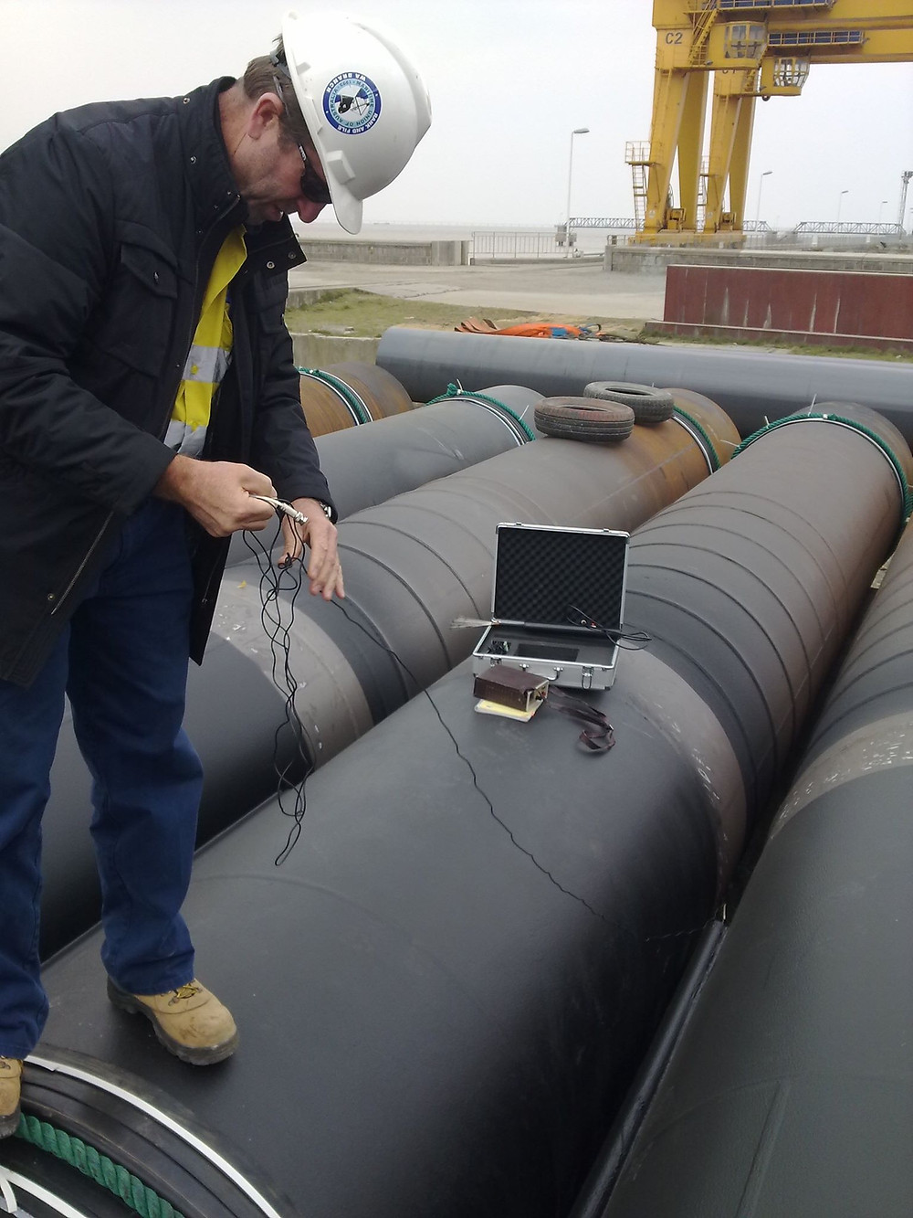 Coating of steel pipes/tubular piles