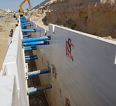 Trench shoring spreader solutions