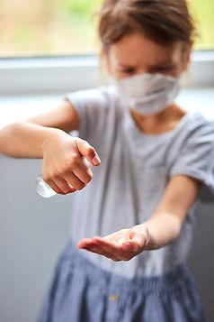 little-girl-wear-hygienic-mask-and-press