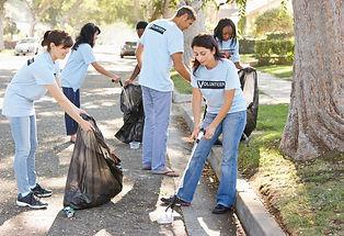 team-of-volunteers-picking-up-litter-in-