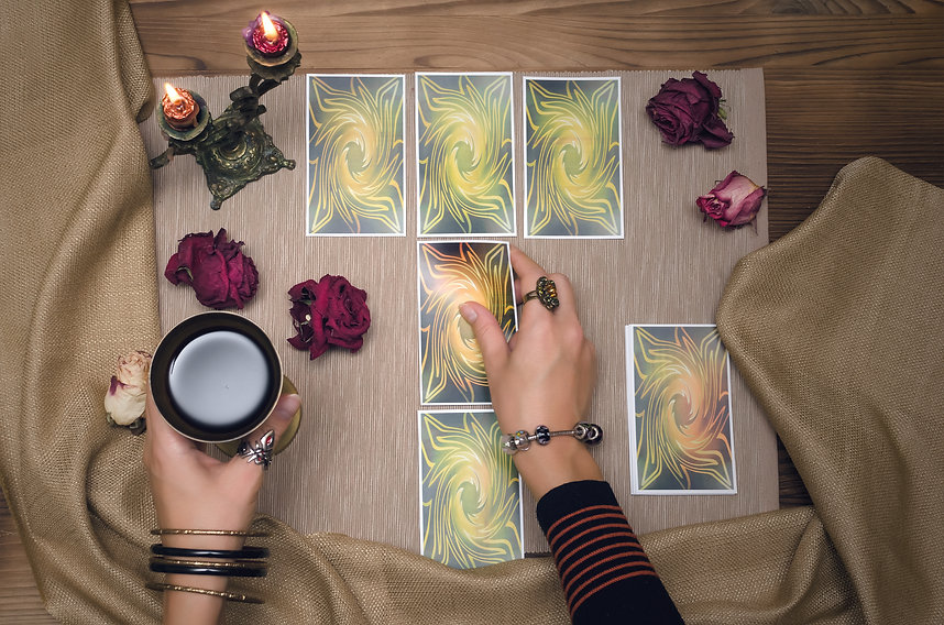 Tarot cards on wooden desk table of fort
