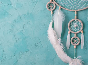 Mint cream dream catcher on turquoise te
