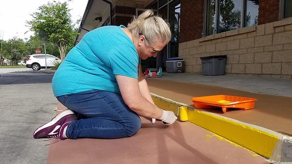 Volunteer Painting Curb.jpg