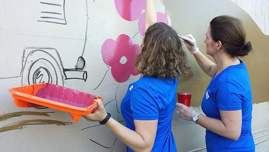 Volunteers Pinting Mural+.jpg