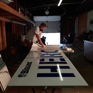 Installing digital print for backlit sig