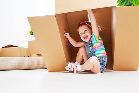 Moving To New Apartment. Happy Child In Cardboard Box.jpg