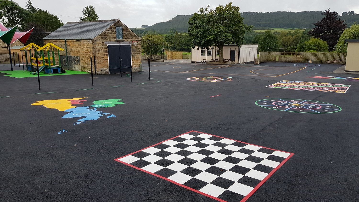 P24 Playground Tarmac Surfacing & Playground Markings at Ashover Primary School in Ashover