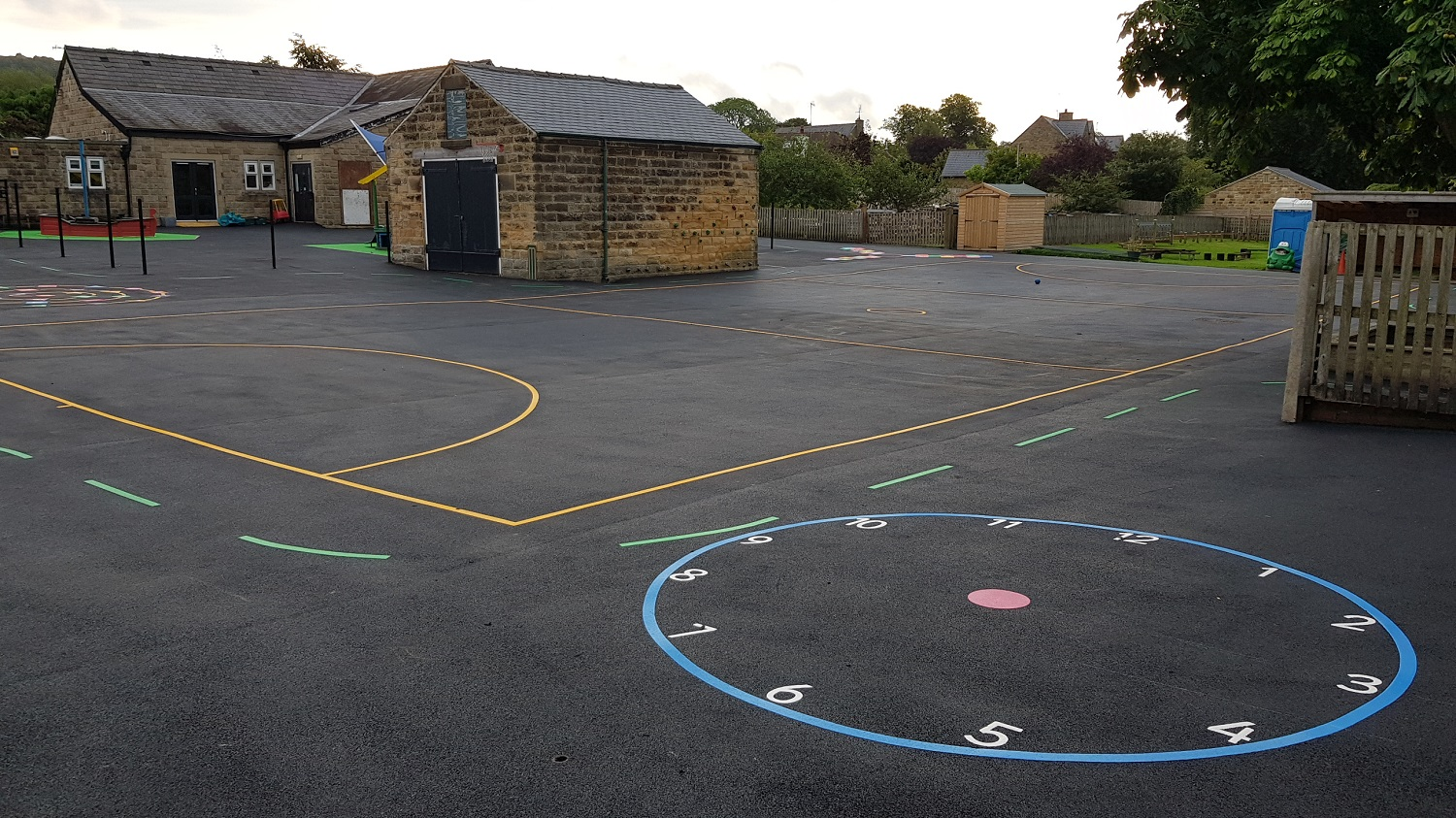 P25 Playground Tarmac Surfacing & Playground Markings at Ashover Primary School in Ashover