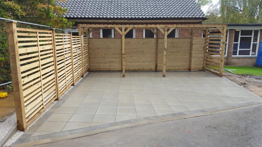 H11 Marshalls Wildwood Pine Paving with Marshalls Drivesett Tegula Pennant Grey Border at Chesterfie