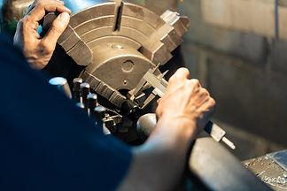 Professional machinist : man operating l