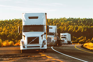 white-volvo-semi-truck-on-side-of-road-2