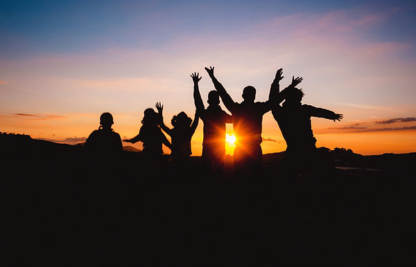silhouette-of-people-raising-hands-durin