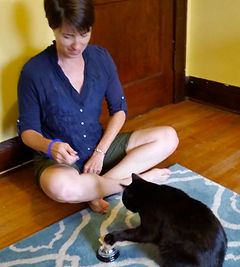 Heather Alvey training a cat to teach it new behavior