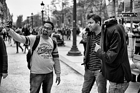 on the champs elysées in paris tourists make a self portrait with a headless man, black and white photo at leica m